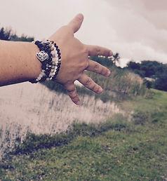 crystal bracelets over lake