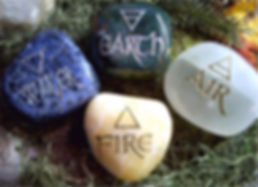 Four elements and their symbols on crystal stones