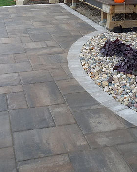 Paver Patio landscaping. Retaining wall landscaping. Shrubs.
