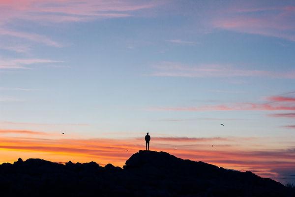 Man at sunset on hill.jpg