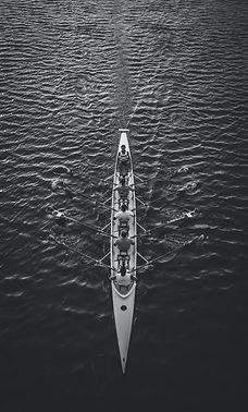 Rowing a boat team.jpg