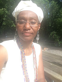 Picture of Theeda Murphy with white headwrap and ilekes