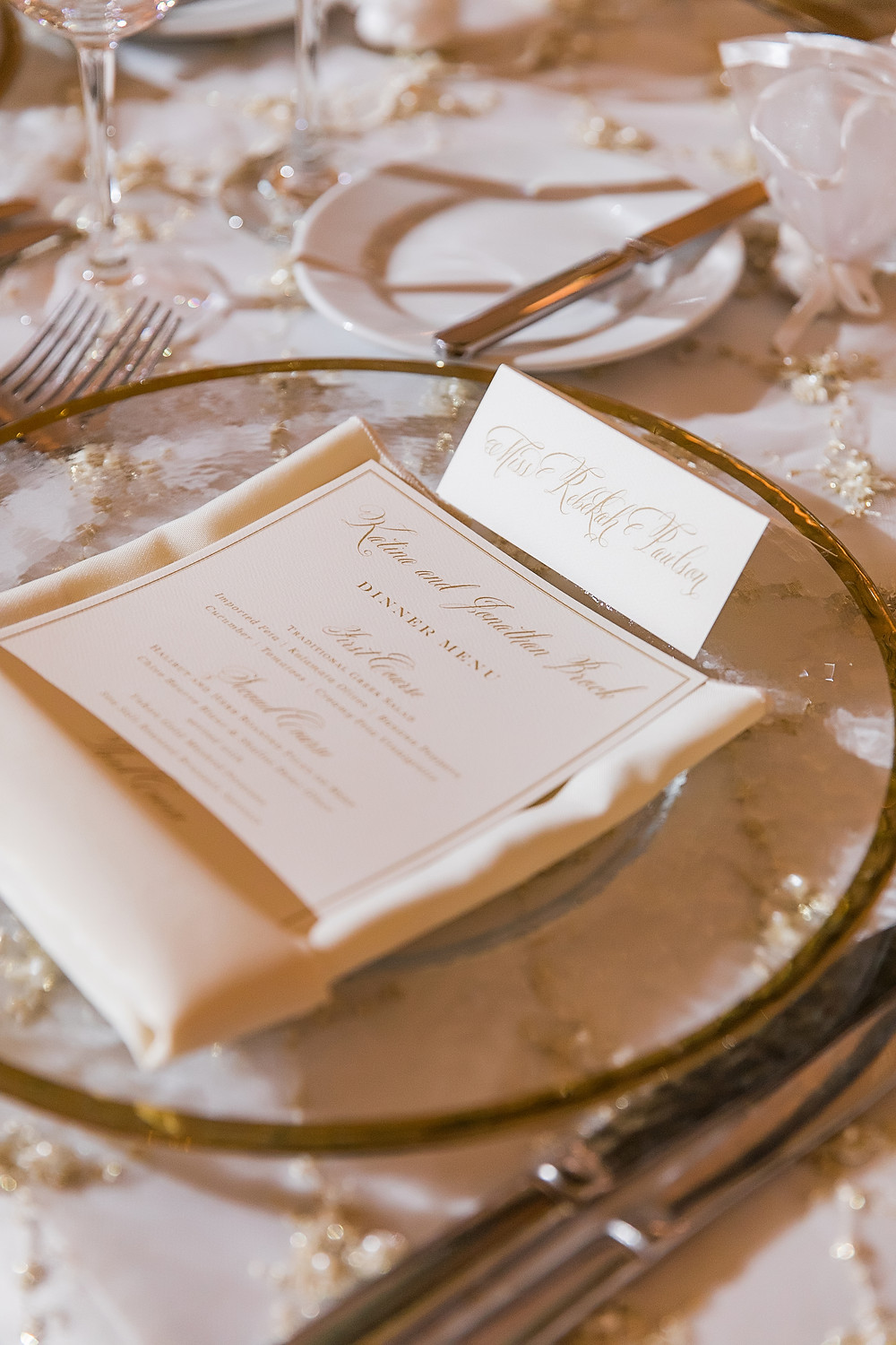 Greet your wedding guest to their seat with a place card and matching menu.