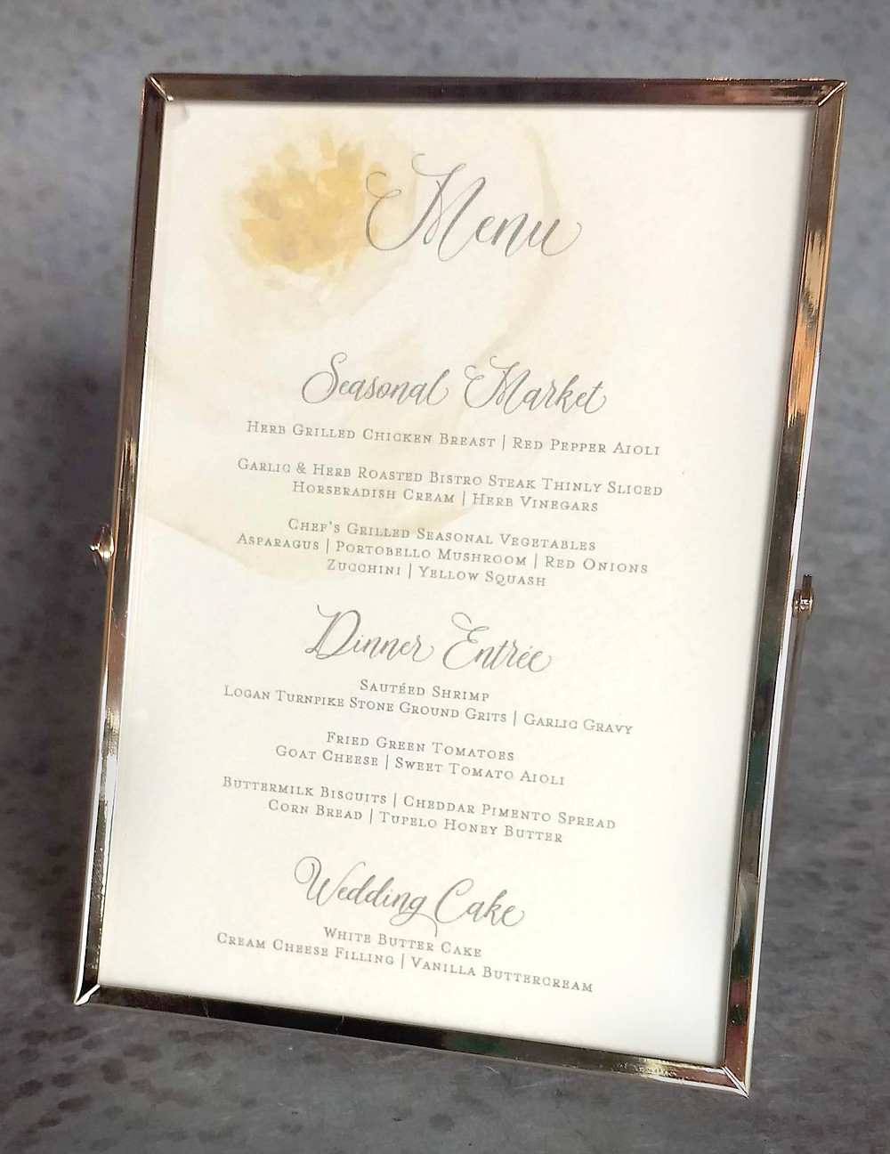 Use a larger framed menu for each table of your wedding to tell your guests their dinner options!