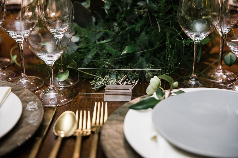 Dress things up with acrylic place cards on your wedding table displays.