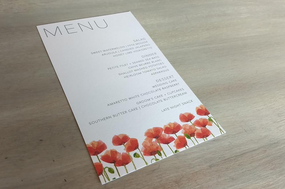 Modern menu featuring poppy florals