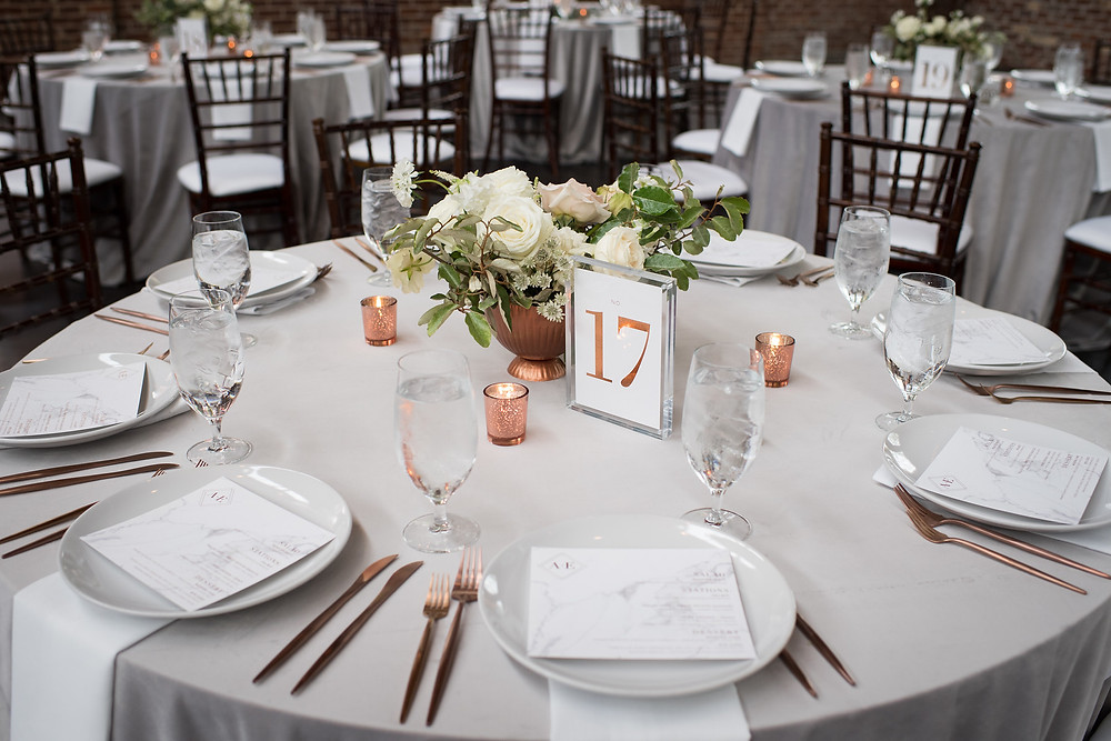 These copper table numbers in our beautiful acrylic frames make for the finishing touch on your wedding reception decor.