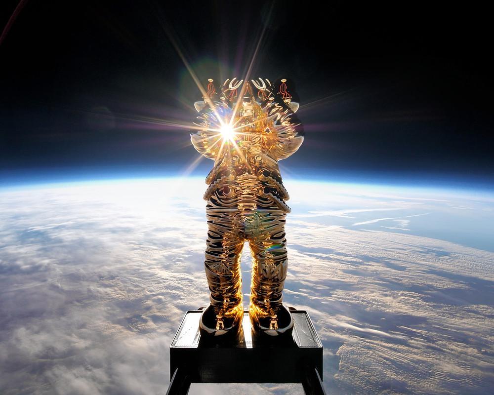a kaws companion figure in space