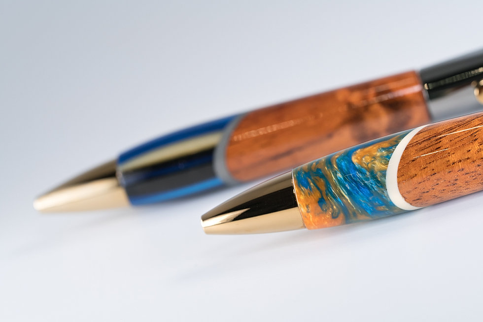 This fountain pen is made of only curly Hawaiian Koa and the metal hardware  is plated with titanium oxide and gold. There was small imperfection in the  wood ...