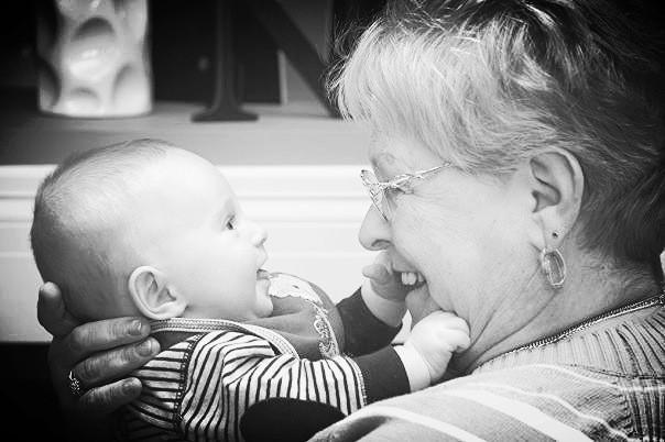 Barbara holding her grandson, Joshua.