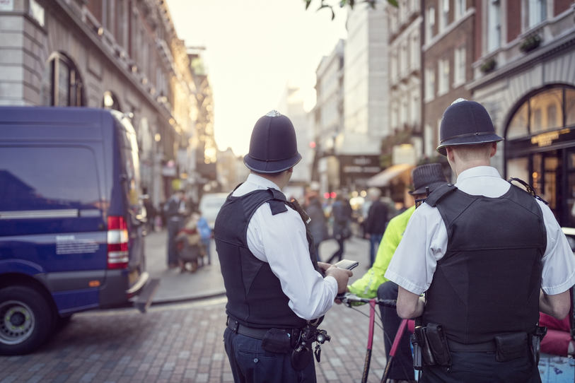 British police officers in helmets polic