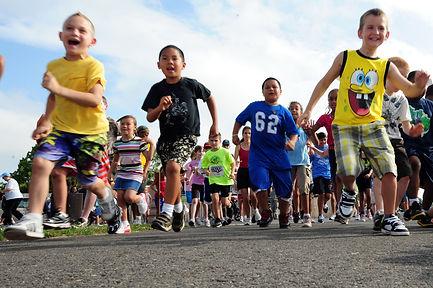 Children and parents running a marathon