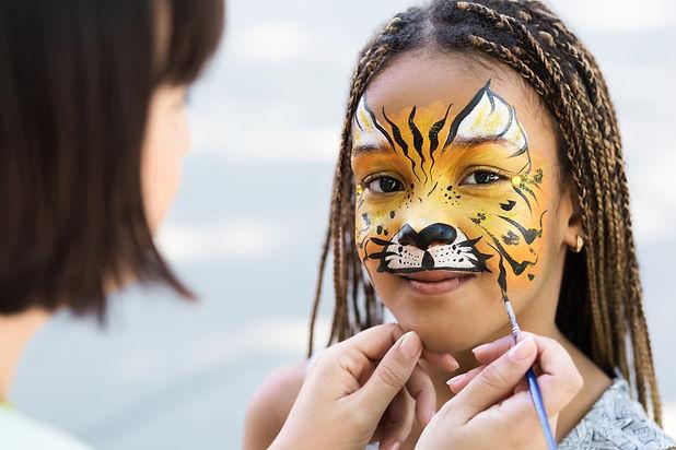 Cute little tiger. African-american girl