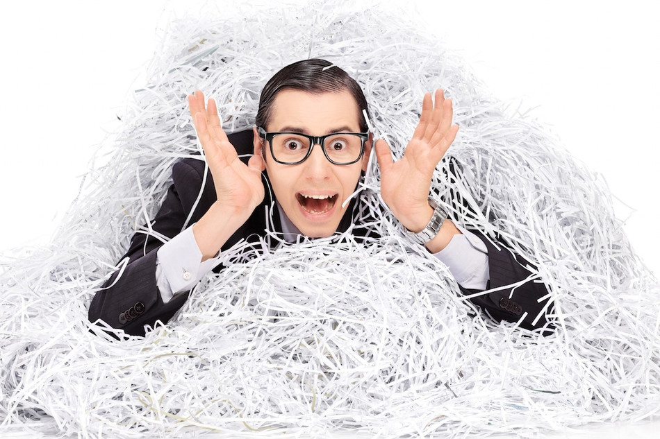 Dangers of not using a paper shredding service while working remotely.
