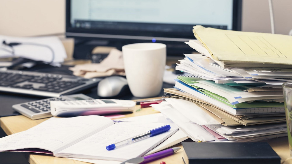 cluttered desks are awful for the release of information and confidential shredding documents