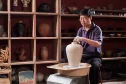 Master Potter Boon trimming pottery