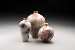Pots with unique colour raku firing