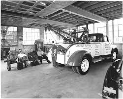 Black-and-white-photo-tow-driver-and-tow-truck