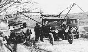 early-1900s-wrecker-truck-wenching-car-off-cliffside