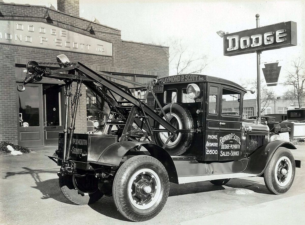 Black-and-white-tow-truck-infront-of-dodge