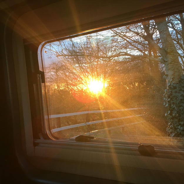 SUNSET THROUGH SIDE WINDOW
