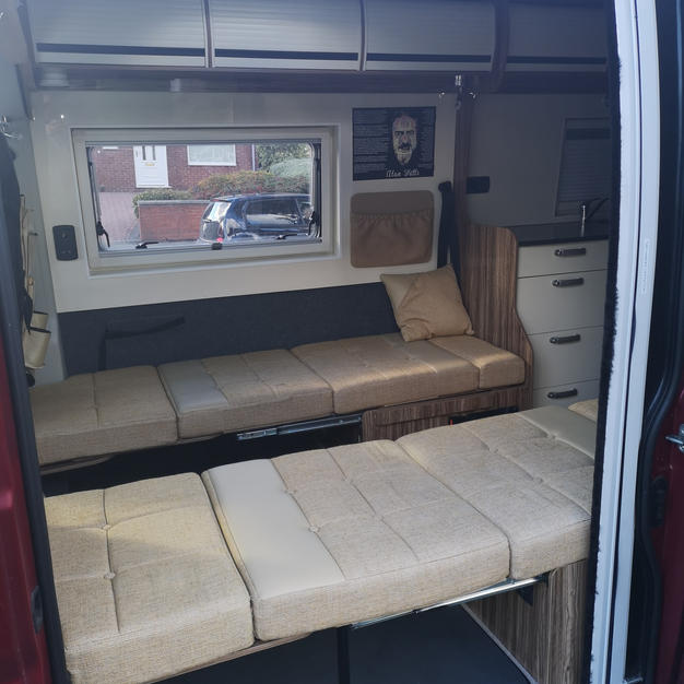 THE SEATS FOLD DOWN INTO 2 SINGLES OR 1 DOUBLE
