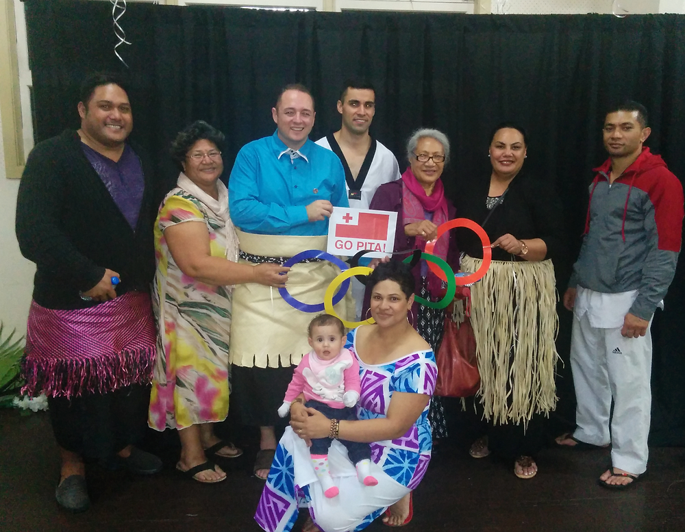 Pita Taufatofua and members of the Tongan Community in Brisbane