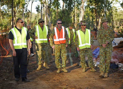 HM King Tupou VI with army members