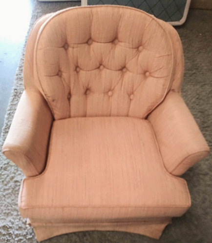 Peach colored swivel rocking chair