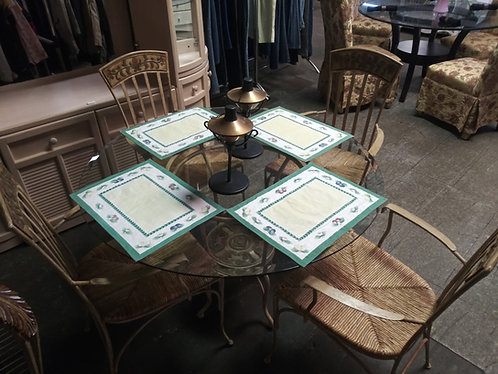 Exquisitely designed glass top table with 4 matching wicker/rattan/iron chairs!