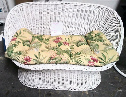 Cute floral wicker bench, perfect for the lanai!