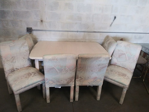 Great quality dining room table with 6 upholstered chairs