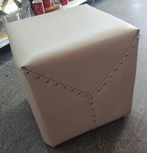 Vinyl wrapped and studded foot stool