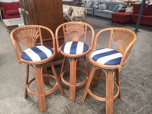 3 beautiful rattan upholstered bar stools