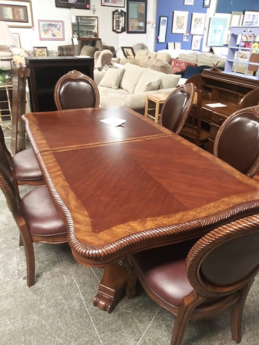 One of a kind Dark Wood Table with 6 Chairs and 2 Extra Leafs