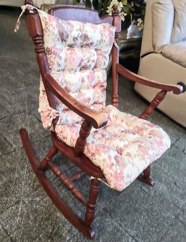 Small vintage rocking chair with cute cushion