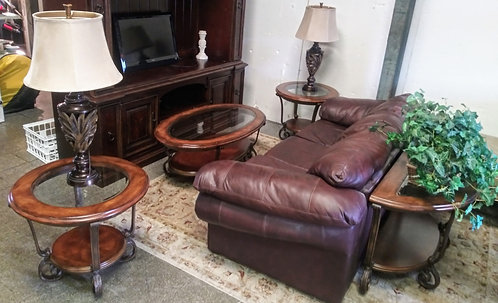 Mahogany entertainment center, brown leather sofa, and much more! Whole set!