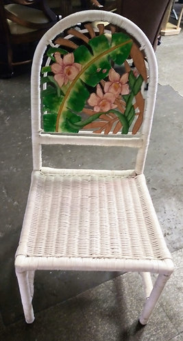 Cute white wicker chair with pretty floral design