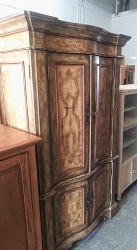 Exquisitely designed T.V. armoire with plenty of space!