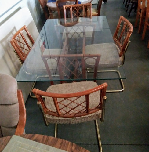 Rattan glass top dining room table with 4 chairs