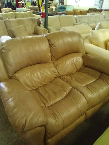 Very comfortable and stylish tan love seat!