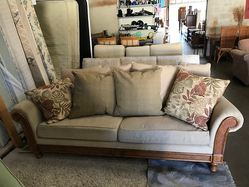 Tan Couch with Wood Trim
