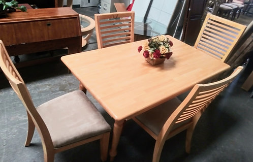 Gorgeous light wood dining room table with 4 microfiber upholstered chairs
