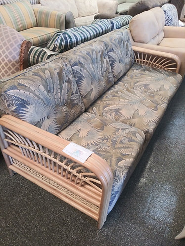 Floral Sofa with Rattan Arms