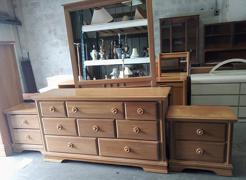 Very modern dresser with mirror and 2 matching nightstands