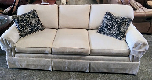 Immaculate cream colored sofa