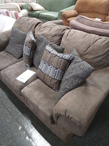 Good quality brown microfiber sofa with accent pillows
