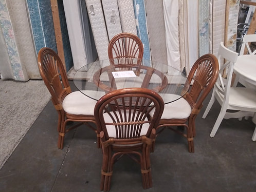 Gorgeous glass top rattan table with 4 chairs