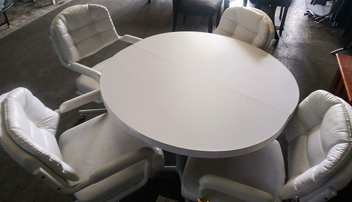 Very nice dinette set with 4 leather upholstered rolling chairs