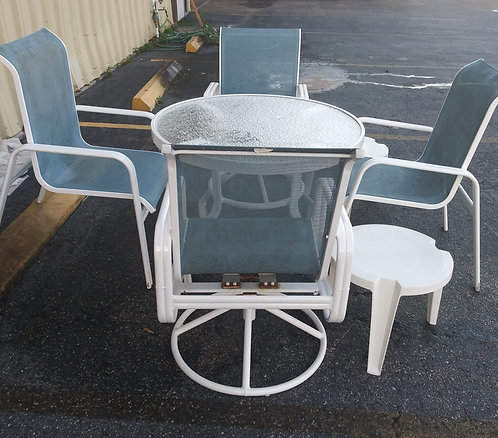 Very sturdy small lanai table with 4 chairs